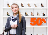 Portrait of woman in shop with 50 sale — Stock Photo