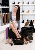 Woman trying on shoes in the shop — Stock Photo