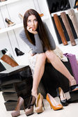 Woman trying on footwear in the shop — Stock Photo