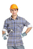 Foreman in range helmet handing hammer — Stock Photo