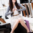 Woman trying on different pairs of pumps — Stockfoto