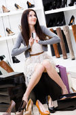 Woman trying on different pairs of pumps — Stock Photo