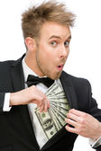Businessman hiding dollars — Stock Photo