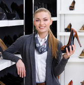 Woman in shop — Stock Photo