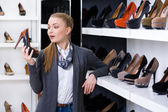 Curious Woman in shop — Stock Photo