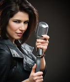 Female rock singer — Stock Photo