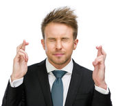 Businessman fingers crossed — Stock Photo