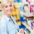 Portrait of young girl at the shop — Stock Photo #46481349