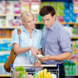 Couple discussing the shopping list — Stock Photo
