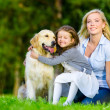 Mother and daughter with pet — Stock Photo #46481917