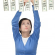 Lady hangs money on the line — Stock Photo #46482995