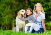 Mother and daughter with pet — Stock Photo