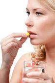 Woman takes pills — Foto de Stock