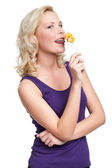 Young female with lollypop — Stock Photo
