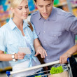 Couple with shopping list — Stock Photo #48472467