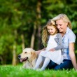 Mother and daughter with labrador — Stock Photo #48472735