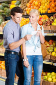 Couple in store — Stock Photo