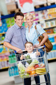 Family drives shopping trolley — Stock Photo