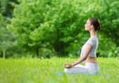 Girl in asana position zen — Stock Photo