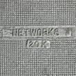 Electric networks as text on vintage metal manhole, telecom. — Foto de Stock