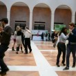Stock Video: Young dancing salsunder tutor instructions in Kiev, Ukraine.