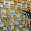 Man fix the cardboard box on the wall during exhibition in Kiev, Ukraine. - Stock Photo