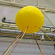 Yellow air balloon near metallic industrial pipes, industry. - Stock Photo