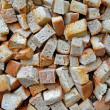 Abstract dry white bread pieces heap, rusk food. — Stock Photo #14369647