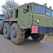 Strong military tractor on the road, special transportation details. - Stok fotoğraf