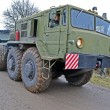 Strong military tractor on the road, special transportation details. - Stock Photo