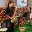 Young girl playing on saxophone in Kiev, Ukraine. - Stok fotoğraf