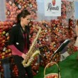 Young girl playing on saxophone in Kiev, Ukraine. — Stok video