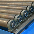 Abstract metal rollers heap, industry details. — Stock Photo #16297849
