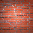 Light over heart sign drawn by white chalk on red brick wall. — Stock Photo