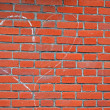 Heart sign drawn by white chalk on red brick wall, love. — Stock Photo #20115111