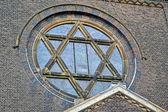 Jewish star on vintage church, stone wall details. — Stock Photo