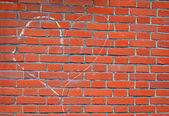 Heart sign drawn by white chalk on red brick wall, love. — Stock Photo