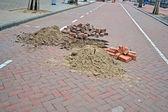Brick road under repair, modern brick highway reconstruction. — Stock Photo