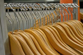 Wooden hanger line, personal accessory heap. — Stock Photo