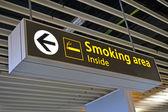 Smoking place sign, airport bigboard. — Stock Photo