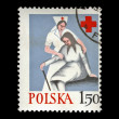 Royalty-Free Stock Photo: Nurse help old woman, Polish Red Cross.vintage post stamp isolated on black.
