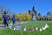 BOSTON - APR 21: Support flags near Washington monument in Public Garden in Boston, USA on April 21, 2013. — Stock Photo