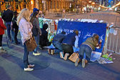 Poured over the memorial set up on Boylston Street in Boston, USA on April 18, 2013. — Stock Photo