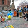 Stock Photo: People poured over memorial set up on Boylston Street in Boston, USA.