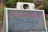 BOSTON -APR 20: Pray for the victims as text near Boylston Street. — Stok fotoğraf