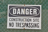 Danger, construction site, no trespassing as warning message. — Stock Photo