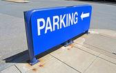Blue parking sign on asphalt, modern transportation. — Stock Photo