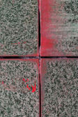 Red painted granite stone wall, construction technology. — Stock Photo
