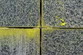 Yellow painted granite stone wall, construction technology. — Stock Photo