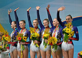 Belarus gymnasts on medal award ceremony during 32nd Rhythmic Gymnastics World Championships. — Stock Photo